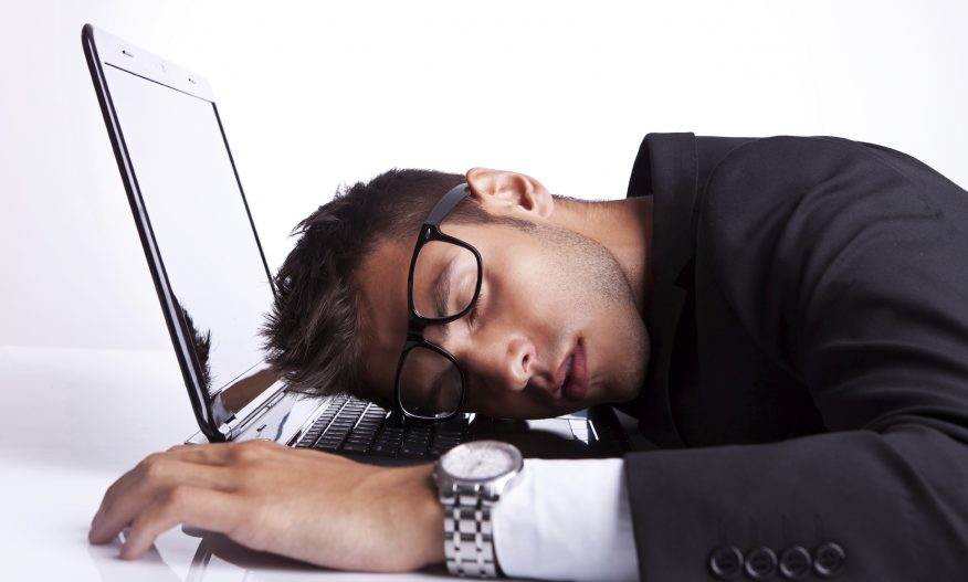Business man sleeping on a laptop computer